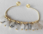 SALE gold bangle with black rutile quartz charms. Made in Ireland