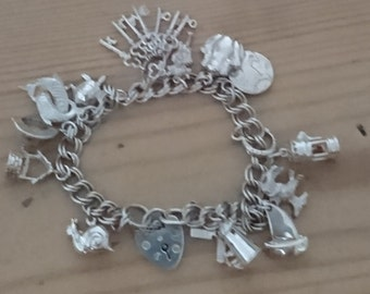 Vintage sterling silver charm bracelet with 14 charms