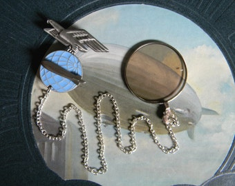 Steampunk Zeppelin Monocle - Very Lightly Tinted Monocle with Chain Lanyard and Antique Airship Insignia Pin