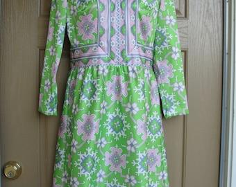 Vintage 1970s or symmetrical floral dress medium 70s 80s