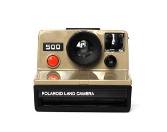 Polaroid 500 Land Camera (Rare edition)  [includes Original Polaroid Soft case]
