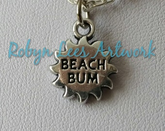 Tiny Silver Beach Bum Sun Charm Surfer Necklace on Silver Crossed Chain with or without Yellow Bead