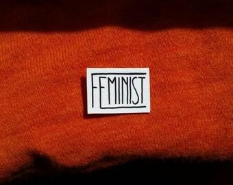 Feminist handmade shrink plastic brooch