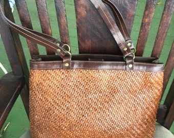 Fossil shiny brown leather woven handbag with brown leather trim