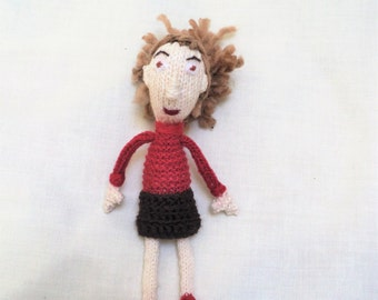 Hand Knitted Doll Wearing a Red and Brown Dress