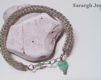 Silver plated wire woven viking knit and green glass bead bracelet