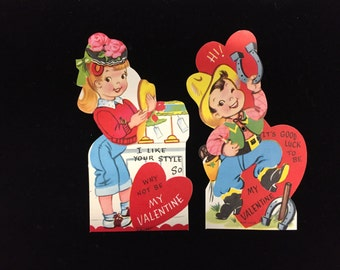 2 vintage retro Valentines w/moving parts:  Redhead trying on hats and cowboy playing horseshoes