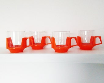 Vintage 1960s Pyrex cups in orange