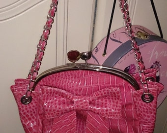 Pink faux crocodile 1980s handbag.Beautifully shaped with large bow and chain strap woven with croc. Feature clasp.