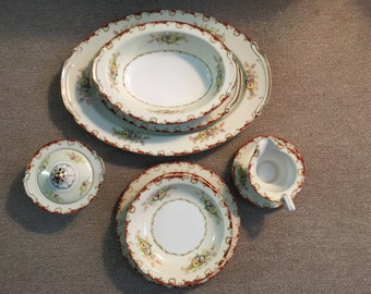 Vintage dinner place setting, in impeccable condition--complete service for 12 with serving platters
