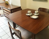 Atomic dining suite by Elliotts of Newbury  teak and rosewood sideboard extending table and 4 chairs mid century