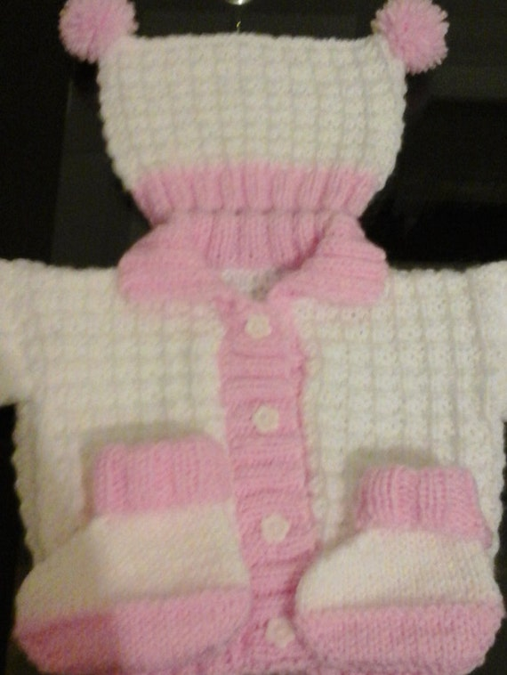 White and pink knitted jacket with tea bag hat by Pollysbabyknits
