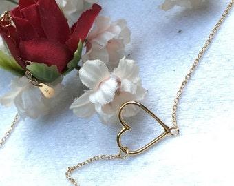 Handmade necklace 14 karat gold plated sterling silver sideways gold heart necklace