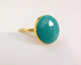 teal and gold ring