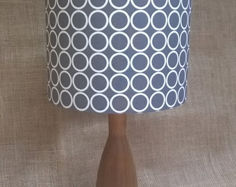 Handmade lampshade with repeated white and pewter circular geometric pattern