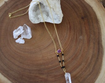Quartz crystal necklace with a gold plated fuschia druzy and black glass beaded gold chain