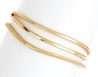 Gold Plated Bangle Bracelets. 14K Gold Plated Wavy Bangle Bracelet Set. Monique Leshman Kiki 14K Gold Plated Wavy Bangle Set.