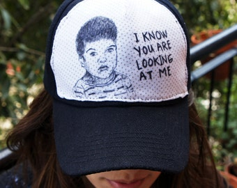 "Cap with baby drawing / Cap with drawing of baby: ""I know your looking at me"", comic and original design"