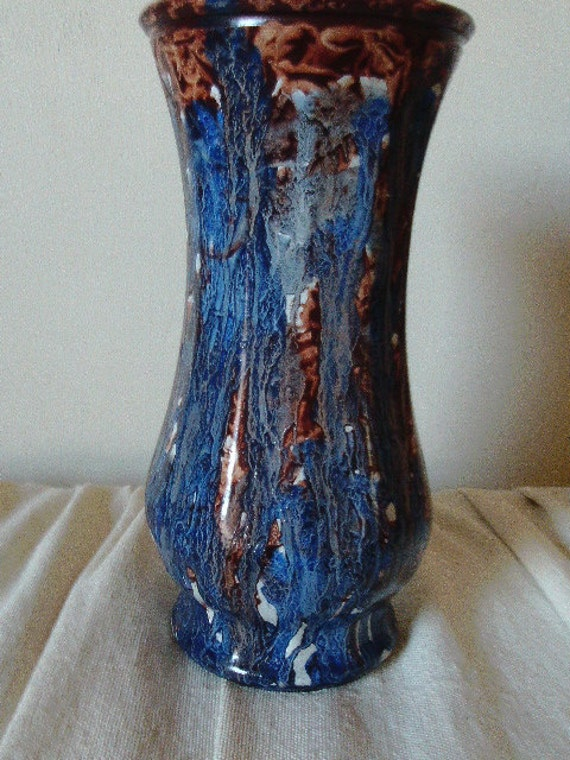 Glass vase vinegar painted in sienna and blue on white