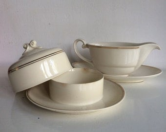 A butter dish and a sauce-tureen