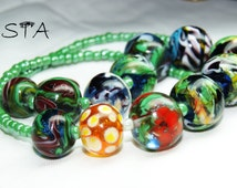 "necklaces , Glass beads. Lampwork. handmade ""House in the flowers"""