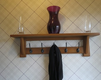 Rustic 5 hook wooden hat and coat rack with shelf.