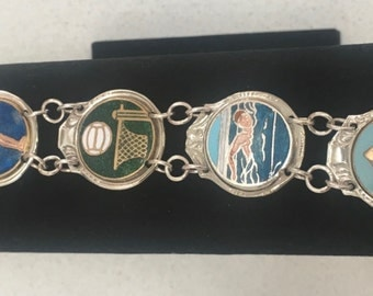 1950's Souvenir medallions bracelet, featuring sporting silver spoons.