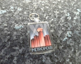 Metropolis Travel Poster Jumbo Keyring. Inspired by the Fritz Lang Science Fiction Film