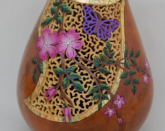 Carved gourds, gourd art, pink flowers, green flower vine, spring blossoms, purple butterfly, filigree, carved relief, carved butterfly