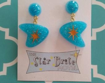 Starburst boomerang drop earrings.