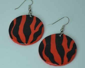 African styling handmade air dry clay earring. Handmade necklace. Red and black.