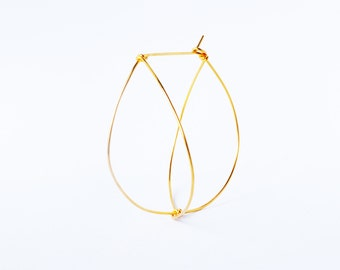 Big gold plated creole hoop earrings. Offered delivery.