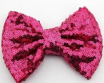Raspberry sequin bow