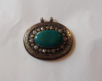 Lovely Afghan Pendant.