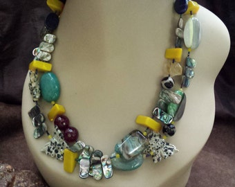 Two strand beaded necklace made with dalmatian jasper butterfly, agate,  yellow quartz, shell and lapiz