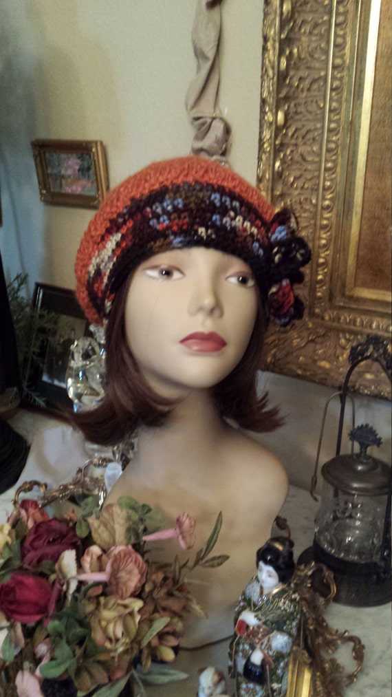 Winter hat with flower on side crochet and designed by petronella