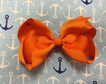 6 inch hair bow in classic orange
