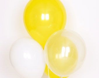 10 yellow assorted balloons: yellow, transparent and white