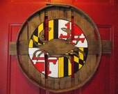 Maryland flag center circle w/ exposed natural wood crab in middle. Hand painted on recycled crab bushel lid.