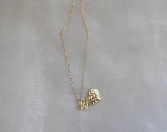 Gorgeous vintage puffed heart and cupid necklace signed NYC