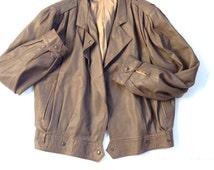 Vintage Italian leather jacket. 70's tan brown pilot jacket. Women's size small to medium outerwear