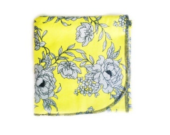 Yellow floral flannel swaddle blanket