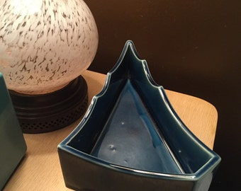 Triangular Shaped Three footed planter signed and made of pottery
