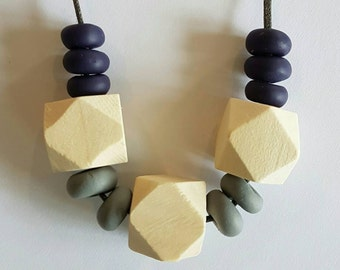Handmade clay and wooden beaded necklace.