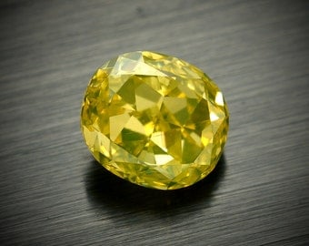 Fancy Intense Yellow Cushion modified .72ct GIA Registered Natural color diamond VS