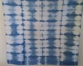 Shibori Wrap with rectangle Shibori design hand-dyed in indigo.
