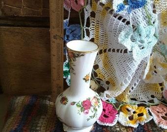 White porcelain gilded vase