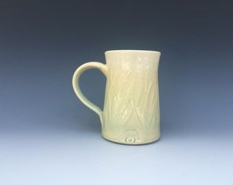 Pale green grass mug