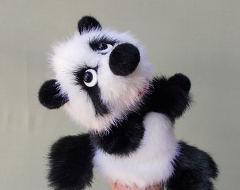 Baby panda. Toy glove. Toy on hand. Bibabo. Puppet theatre. Marionette.