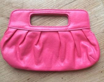 Electric pink clutch bag